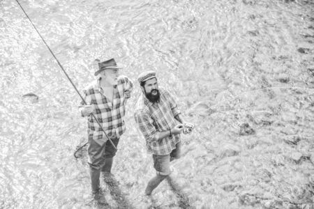 leisure. concept of a rural getaway. hobby. wild nature. two happy fisherman with fishing rod and net. Big game fishing. friendship. father and son fishing. Poaching. Camping on the shore of lake Stock fotó
