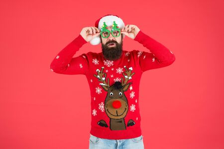 Awesome Christmas. knitwear fashion. winter holiday celebration. ho ho ho. bearded man santa hat. christmas is here. man in xmas party glasses. happy new 2020 year. funny hipster knitted sweater.