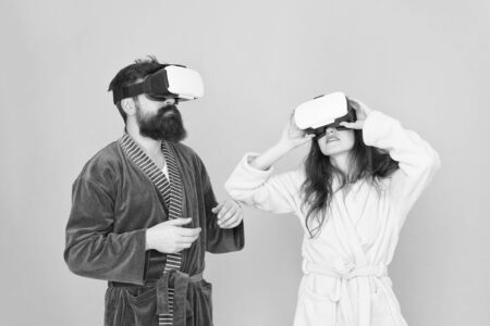 girl and man hipster relax in bathrobe. Future is now. digital couple. innovation in family relations. create your reality. world of immagination. family couple wear vr glasses. This is cool.