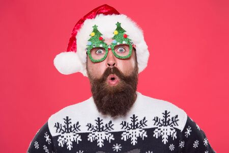 Surprised face. Happy bearded man with santa look. Holiday accessories for santa party. Christmas and New Year celebration. Good mood. Santa is coming. Santa man wear christmas tree party glasses.