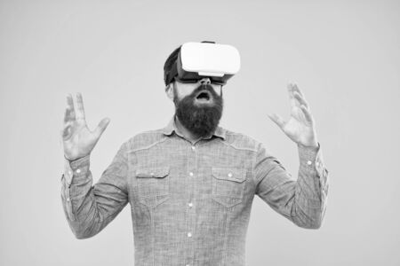 Cyber sport. Augmented reality. Enjoy game in 3D space. Game development. Digital technology. Living alternative life. Hipster play video game. Bearded man explore vr. Gamer concept. Gaming hobby. Stock fotó