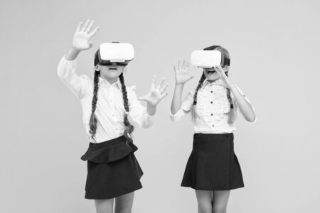 Exploring augmented reality. Experiences communicate and manage projects.Kids use modern VR technology. Virtual reality. VR headset. Future education. Children schoolgirls wear wireless VR glasses.