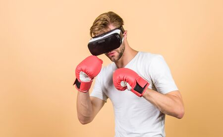no pain no gain. modern gadget. Training boxing game. boxing in virtual reality. Digital sport success. vr boxing. future innovation. man in VR glasses. Futuristic gaming. man use new technology. Stock Photo