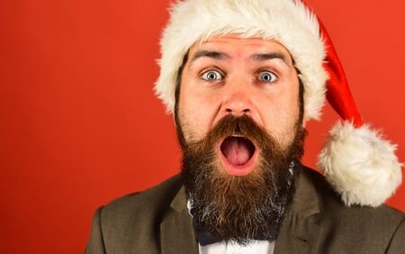 Man with beard and shocked sight on red background.