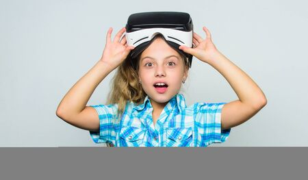 Digital future and innovation. Little child in VR headset. Happy kid use modern technology. Small child wear wireless VR glasses. Little girl wearing virtual reality goggles. Enjoying new reality