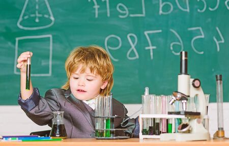 Kid study biology chemistry.