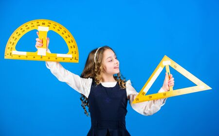 Smart and clever concept. Girl with big ruler. School student study geometry. Kid school uniform hold ruler. School education concept. Sizing and measuring. Learn mathematics. Theorems and axioms Banque d'images