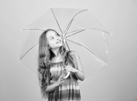 Weather forecast. Rainy days coming. Love rainy days. Kid girl happy hold transparent umbrella. Enjoy rainy weather. Invisible protection. Fall season. Enjoy rain concept. Waterproof accessory Stock Photo