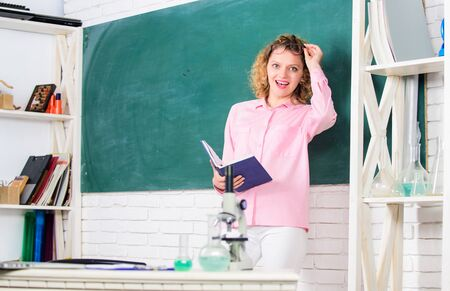 Girl adorable teacher in classroom. Educational process concept. Educational methods include storytelling discussion teaching training and directed research. Educational program for primary school