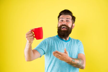 Herbal tea. Aromatic beverage. Understand value taste really great cup of coffee. Coffee shop. Bearded man satisfied drink morning coffee. Energy concept. Hipster stylish barista yellow background