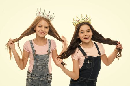 Its pride that drives them. Adorable little princesses in crowns with long hair source of their pride. Cute small girls feeling great pride of their hairstyles. Pride and joy