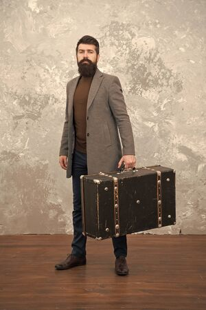 Retro and vintage. Fashion trend. Accessories for vacation. Best travel bags for men. Guy well groomed elegant bearded man and vintage suitcase. Time traveller concept. Vintage inspired design of bag