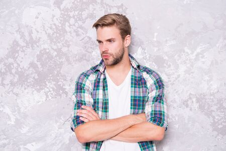 good man hard to find. mens sensuality. guy casual style. macho man grunge wall. male fashion summer trend. confident student checkered shirt. unshaven man care beard. barbershop concept