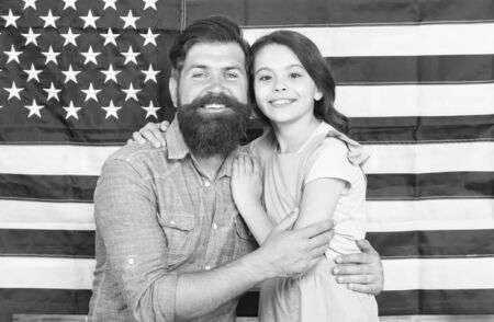 National glory. Bearded man and little child on national flag of the USA. American family celebrating national holiday on july 4th. National and patriotic education and upbringing