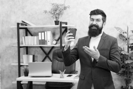 modern innovation. Businessman in formal outfit. Confident man. Boss workplace. Coffee break. Bearded man in business office.