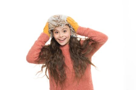 Faux fur trend. Girl long hair wear fur hat white background. Softener for woolen garments.