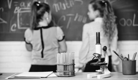 Little scientist work with chemistry microscope. Chemistry research. Biology lesson. Back to school. science experiments in chemistry laboratory. Little girls in school lab. Chemistry education.
