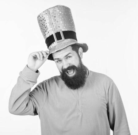 Touching hat to somebody. Happy hipster in leprechaun hat and costume. Bearded man celebrating saint patricks day. Irish man with beard wearing green. Happy saint patricks day