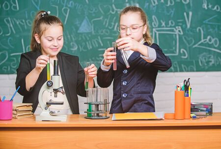 Inspire. Little girls scientist with microscope. Biology lab. Happy Genius. Little girls genius in school lab. Science lab. science experiments in laboratory. Chemistry research in laboratory