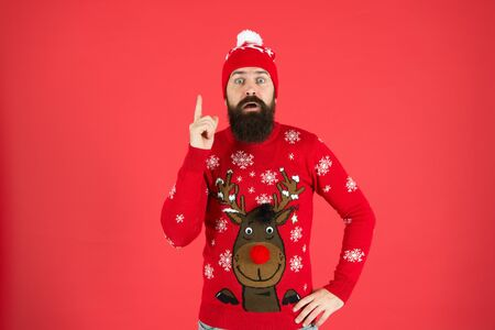 Consequence. Be careful. Warning concept. New year concept. Join winter holiday party. Christmas Party. Winter outfit. Hipster emotional bearded man wear winter sweater and hat red background