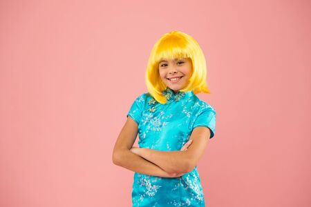 Japanese style. Eastern trends for teens. Hobby and entertainment. Pop culture. Anime fan. Cosplay kids party. Child cute cosplayer. Cosplay outfit. Otaku girl yellow wig. Cosplay character concept Stock Photo