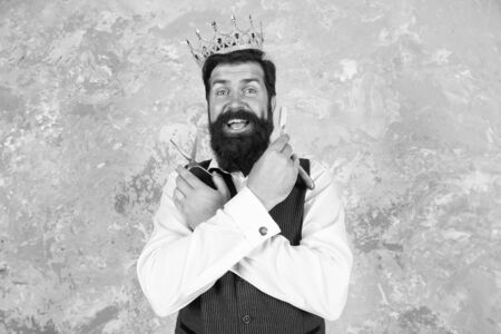 Oh my gosh. Barber with surprised bearded face. Bearded big boss wear crown. Bearded man hold scissors and razor. Barber tools. Luxury barbershop. Trendy hairstyle for bearded hipster