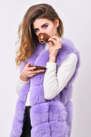 Elite coffee concept. Elite coffee variety concept. Elite drink with caffeine. Lady drink espresso little ceramic cup white background. Enjoy aroma and taste hot coffee. Woman fur coat drink coffee
