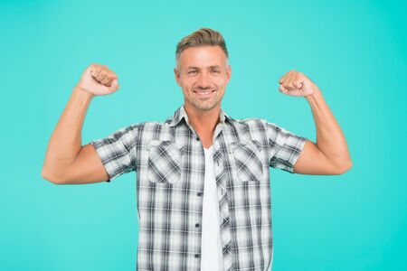 I can. Strong man blue background. Muscular man flex arms. Handsome man in casual style. Caucasian man show power. Fashion and style. Fitness and gym. Workout and training