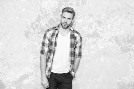 male fashion spring collection. charismatic student checkered shirt. unshaven man care his look. barbershop concept. mens sensuality. sexy guy casual style. macho man grunge background