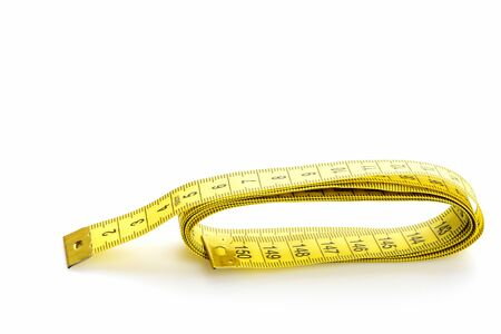 Ruler for sewing in yellow color with black numbers, isolated on white background with copy space. Minimalistic concept of diet and fitness Banco de Imagens