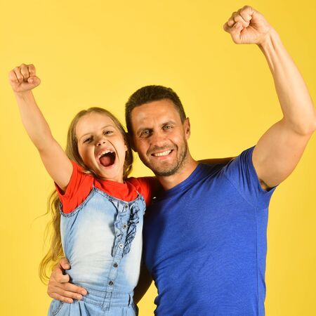 Girl and man with happy faces on yellow background