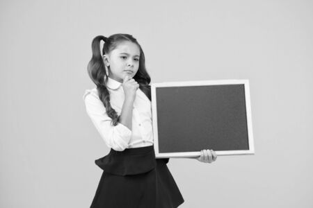 Do not forget. Schoolgirl pupil informing you. School girl hold blank chalkboard copy space. Announcement and promotion. Check this out. Girl school uniform hold blackboard. Back to school concept