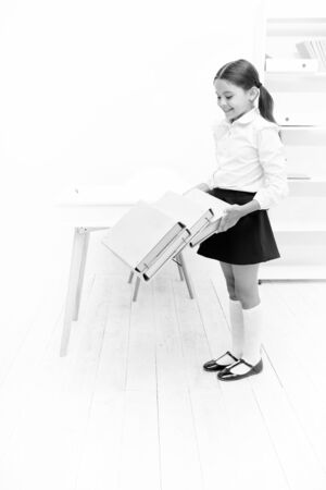 Capricious girl. smiling girl with workbook folders. Education. heavy documents. Towards knowledge. small girl in school uniform. lot of homework. Get information. kid study hard. back to school