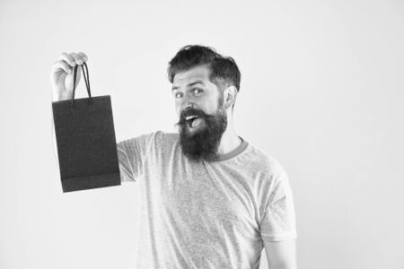 best offer. Man with gift package. Buy product. little pleasantness. bearded man go shopping. mall for men. mature male beard with fashion purchase. happy hipster hold paperbag. copy space