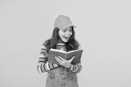Informal education concept. Join school literature club. Child happy smiling girl with notepad book enjoy studying non formal atmosphere. Education is fun. Education outside of structured curriculum