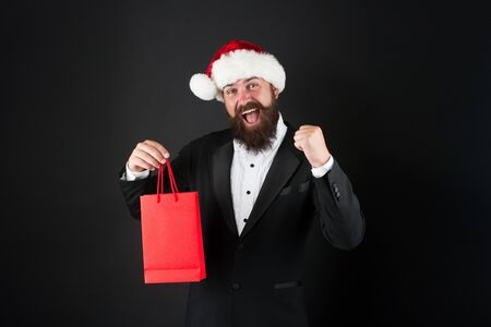 Buy new year gifts. Shopping for presents. Nice purchase. Meet all your festive season needs with our winter clothes. Additional services. Shopping with joy. Handsome bearded man hold shopping bags