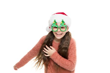 Run away. Christmas holiday. Small girl in santa hat. Having fun. Happy child christmas tree eyewear accessory booth props. Little santa. Christmas event and entertainment. Happy about new year Stock Photo