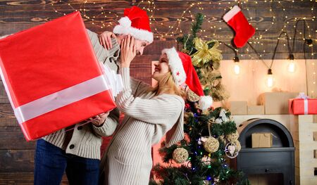 Man and woman with gift box. Smiling guy with giant present. Spread happiness. Giving happiness. Generous giver. Preparing presents for christmas. Winter happiness. Happy and satisfied. Santa Claus. Imagens