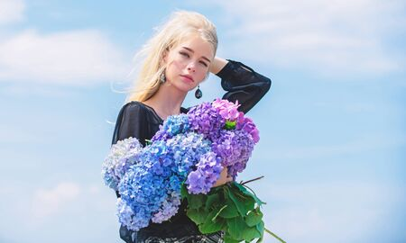 Enjoy spring without allergy. Allergy free life. Stop allergy blooming season. Springtime bloom. Female adore flowers. Girl tender blonde hold hydrangea bouquet. Pollen allergy. Spring attributes