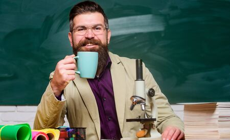 chemistry lesson. mature teacher at blackboard. Towards knowledge. good morning coffee. back to school. using microscope. biology education. happy bearded man hipster drink tea at school