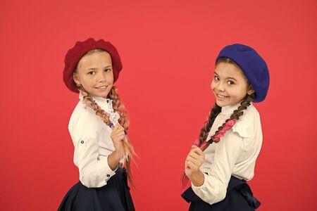 Best friends. Schoolgirls wear formal school uniform. Children beautiful girls long braided hair. Little girls with braids ready for school. School fashion concept. Fancy style. School friendship