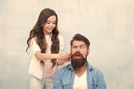 With healthy dose of openness any dad can excel at raising girl. Child making hairstyle styling father beard. Being parent means present for kid interests. Change hairstyle. Create funny hairstyle