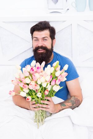 love valentines day. womens day. tulip flower for march 8. good morning flowers. positive mood and happiness. happy bearded man in bed. birthday gift bouquet. spring fresh tulip. Spring allergy