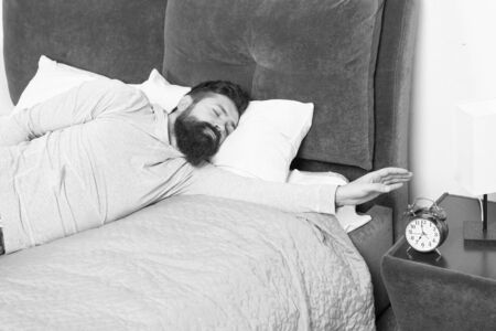 early morning awakening. hate noise of alarm clock. Stages of sleep. Man at home. Health care concept. need more relax in bed. stressed and unhappy man. bearded man hipster want to sleep