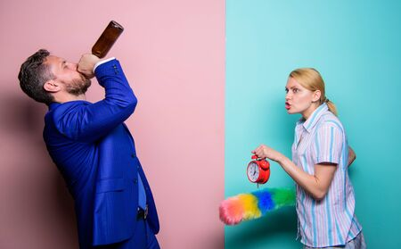 woman clean house. housekeeping business.cleaning service. family routine. relations problems. segregation of duties. man alcoholic drink wine Stock Photo