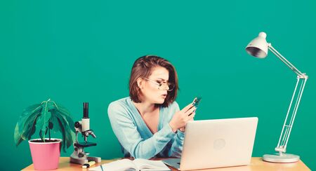 Education concept. Student life. High school education. Online remote classes. Read incoming message. Nerd girl. Check social networks. Girl pretty attractive student with laptop. Modern student Stok Fotoğraf