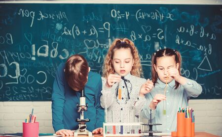 students biology experiments with microscope in lab. Chemistry equipment. Little kids learning chemistry in school lab. Happy children. Chemistry lesson. Chemistry education. Confident scientist