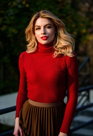 Femininity and tenderness. Autumn stylish outfit. Fall fashion. Woman walk in autumn park. Cozy knitwear. Knitted sweater. Adorable girl enjoy sunny autumn last sunbeams. Fashionable clothes Archivio Fotografico