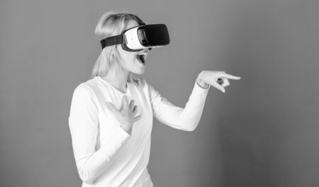Woman excited using 3d goggles. Funny woman experiencing 3D gadget technology - close up. Woman with virtual reality headset. Interfaces.