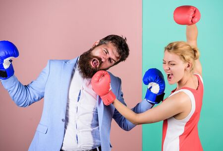 Gender battle. Gender equal rights. Gender equality. Man and woman boxing fight. Couple in love competing in boxing. Conflict concept. Family quarrel. Boxers fighting in gloves. Domination concept